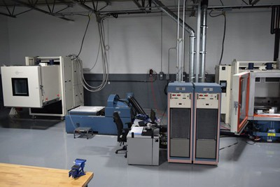 Heavy equipment in a test lab used for vibration testing on automotive and aerospace parts